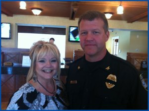 Margie Johnson, Post Office Manager shares a photo with Officer Worley