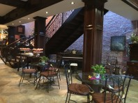 The lobby of the Remington has a cozy courtyard feel